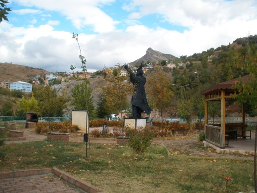Pir Sultan Abdal statue at Tunceli looking towards town